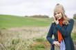 Portrait of a woman standing in a field