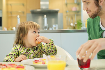 Man and daughter at breakfast table