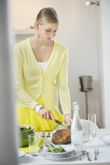 Woman cutting bread for dinner
