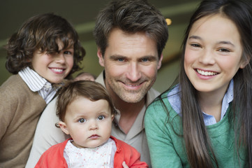 Portrait of a happy man with their children smiling