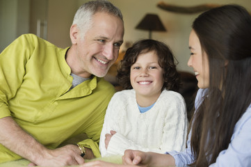 Close-up of a man with his children smiling