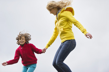 Woman with her son jumping and smiling