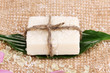 Leinwandbild Motiv Hand-made herbal soap on sackcloth