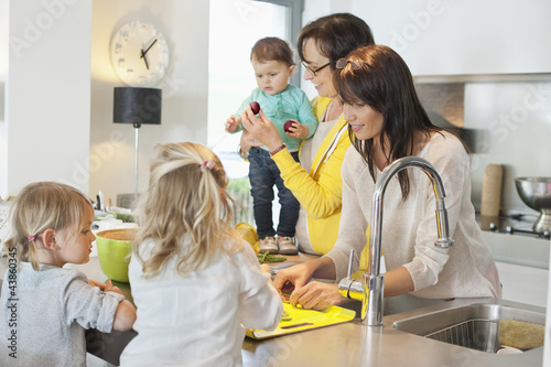 Girls with her mother and grandmother in a kitchen