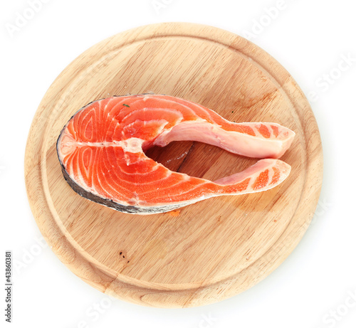 Red fish with on wooden cutting board isolated on white.