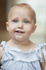 Close-up of a baby girl smiling