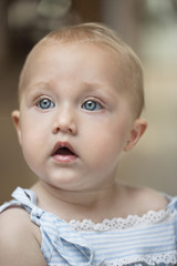 Close-up of a baby girl looking away