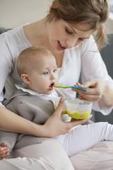 Woman feeding her daughter