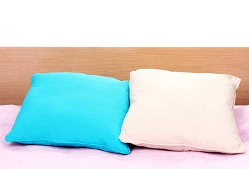 bright pillows on bed on white background
