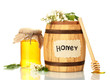 Sweet honey in barrel and jar with acacia flowers isolated