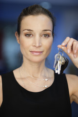 Portrait of a businesswoman holding keys