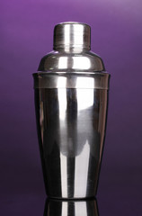 Cocktail shaker on violet background