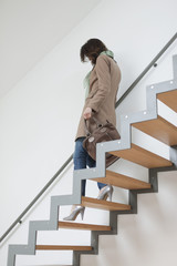 Woman moving down stairs