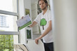 Man holding an ecological poster showing wind turbine