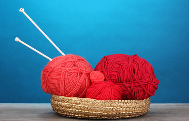 Red knittings yarns in basketon