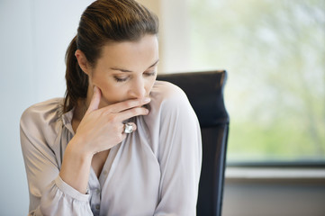 Close-up of a businesswoman thinking in an office