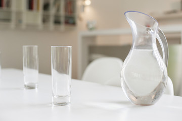 Jug of water and glasses on a dining table