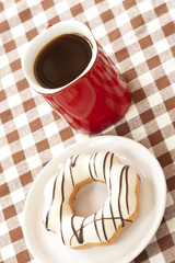 Donut and red coffee cup