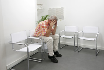 man sitting in waititng room