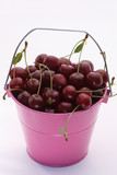 Bucket with ripe cherries on white background