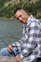 Happy man fishing