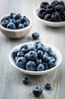 Blueberries and blackberries in small bowls