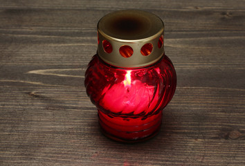 Memory lantern with candle on wooden background