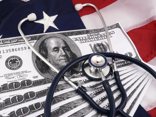 100 Dollar Bills And Stethoscope Over American Flag