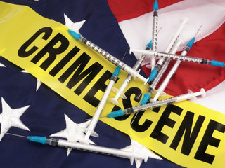 Syringes And Crime Scene Cordon Tape Over American Flag