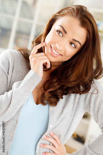 Gorgeous young woman thinking of the future