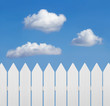 White wooden fence against blue sky
