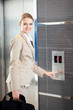 beautiful young businesswoman using elevator