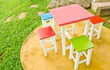 colorful chairs and table in garden