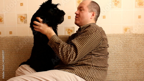 scottish terrier puppy and the owner