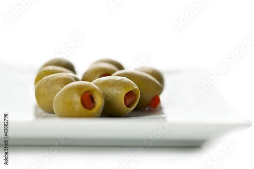 olive fruit in white plate