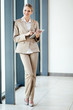 happy young businesswoman full length portrait