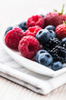 Fresh berry fruits on a plate