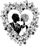 Silhouette of groom and bride with beautiful floral heart