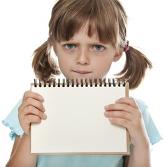 little girl holding empty white notebook