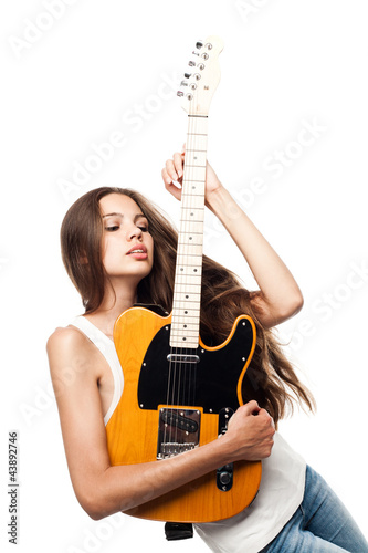 Beautiful young woman with electric guitar