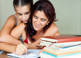 Latin mother and daughter studying at home