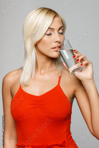 Woman enjoying fresh water with closed eyes