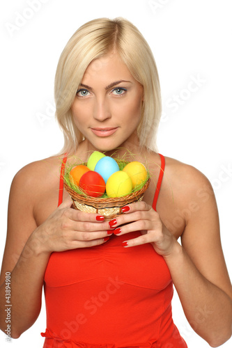 Female in bright red dress holding basket with Easter eggs
