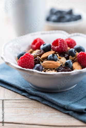 Muesli with fresh fruits, almonds and raisins