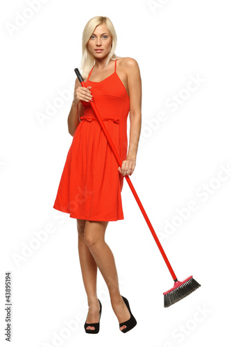 Full length of woman standing with broom