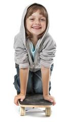 little girl on skateboard isolated against white background