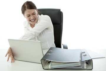 young brunette business woman in rage and throw laptop of desk