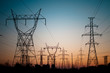 Leinwanddruck Bild - Electrical Transmission Towers (Electricity Pylons) at Sunset