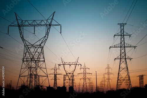 Leinwanddruck Bild Electrical Transmission Towers (Electricity Pylons) at Sunset