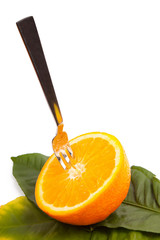 cut orange with a plug on leaves